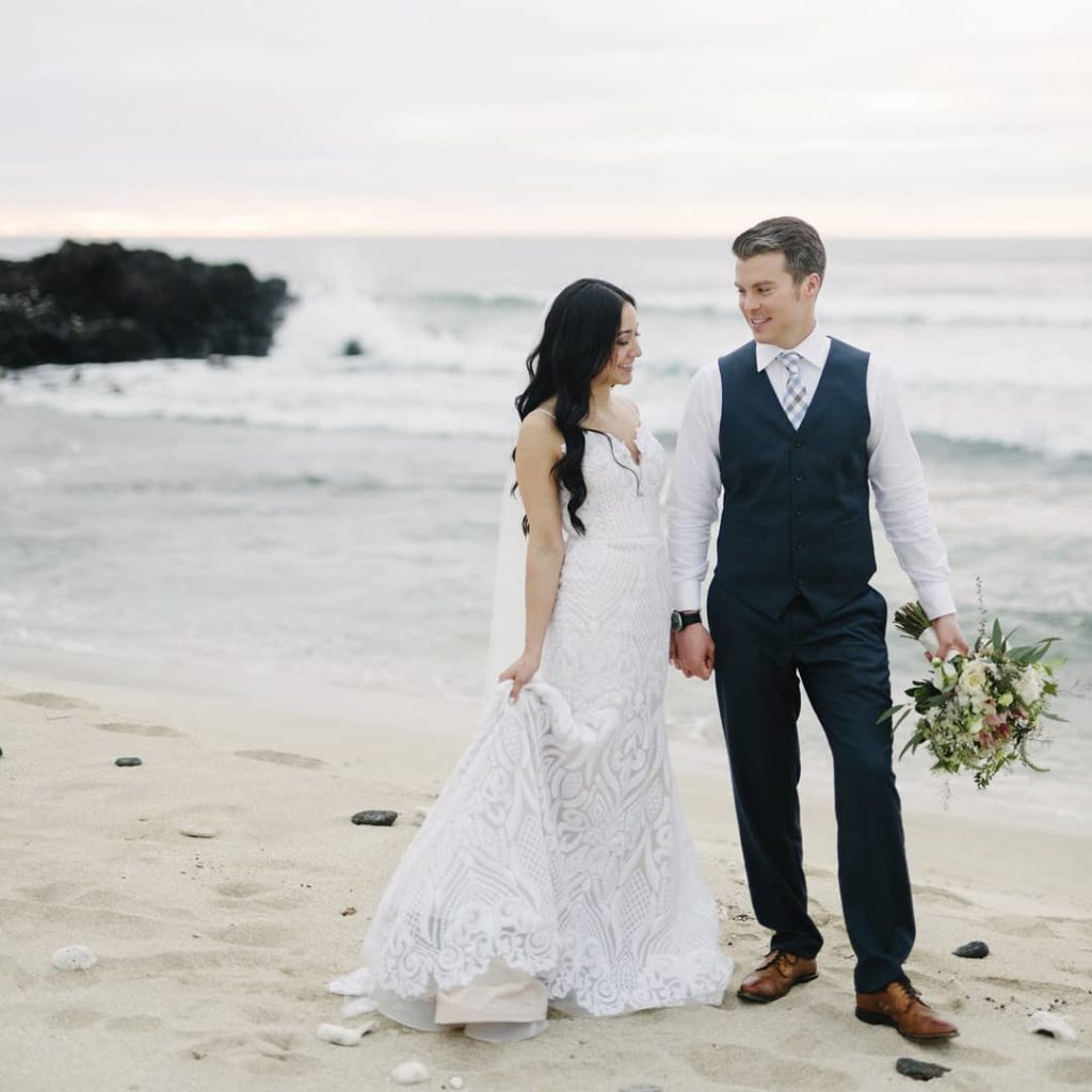 Our #BitsyBride Amber in her perfect dress, West by Hayley Paige, in Hawaii. Photography by Bikini Birdie.